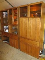 THREE MID CENTURY OAK FINISH DISPLAY/ENTERTAINMENT CABINETS